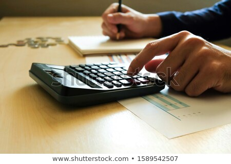 Infographics , Calculations of Business man in Suit Stock photo © robuart