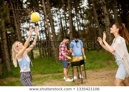 Las mujeres jóvenes jugando voleibol primavera naturaleza hombres Foto stock © boggy