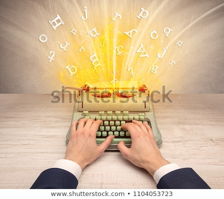 Stock photo: Letters Exploding From A Vintage Typewriter