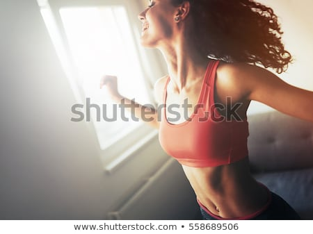 Slender sporty woman, fitness girl in sportswear Stock photo © MarySan