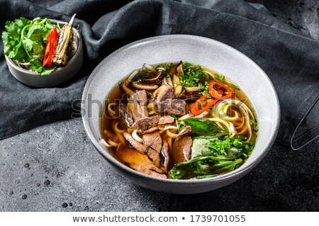 Pho Bo - Vietnamese fresh rice noodle soup with beef, herbs and chili. Vietnam's national dish BANNE Stock photo © galitskaya