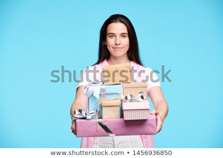 Young brunette female giving you stack of giftboxes Stock photo © pressmaster