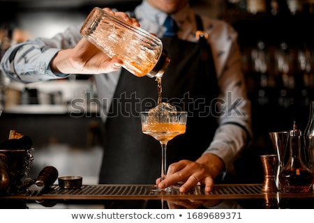 Bartender shaking cocktail in cocktail shaker at bar counter in nightclub Stock photo © wavebreak_media