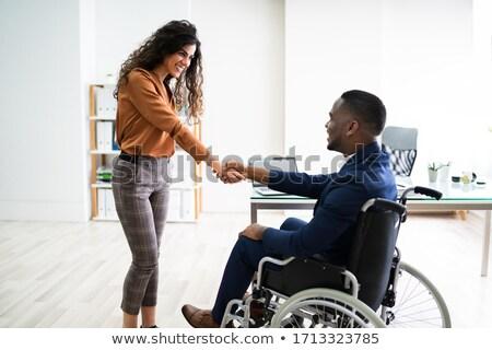 Zakenman handen schudden gehandicapten zakenvrouw kantoor handen Stockfoto © AndreyPopov