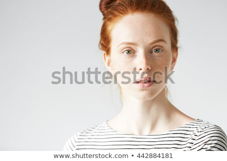 Close up portrait of young serious girl with  focused look.  Stock photo © lichtmeister