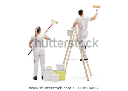 Kobieta malarz odizolowany biały budowy ściany Zdjęcia stock © Elnur