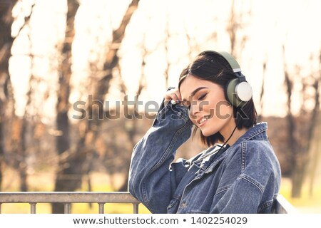 Pretty, young woman with headphones outdoors Stock photo © lightpoet