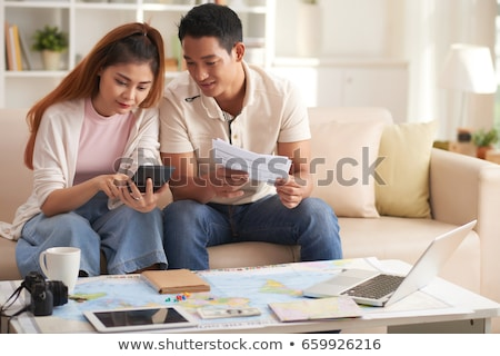 The young family discussing travel plans with map Stock photo © Elnur