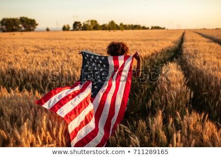 Mutlu kız amerikan bayrağı tahıl alan gün ülke Stok fotoğraf © dolgachov