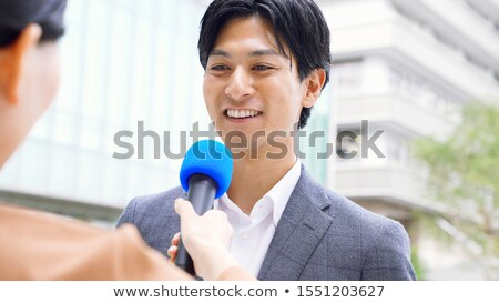 Reporter interviewing young man Stock photo © photography33