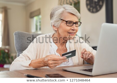Elderly woman using a card online Stock photo © photography33