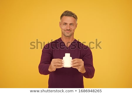Man smelling aftershave cologne Stock photo © lovleah