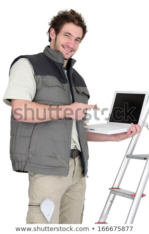 Tiler pointing to laptop Stock photo © photography33