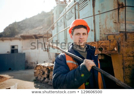 Young man with a sledgehammer Stock photo © photography33