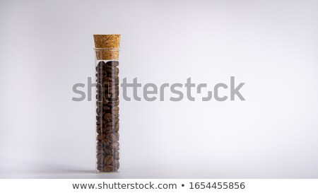 coffee beans in a glass jar on white background stock photo © happydancing