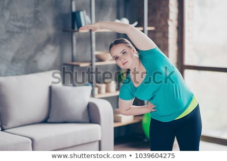 Shapely girl with green workout clothing Stock photo © stryjek