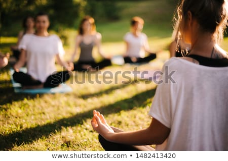 Woman sitting on the grass contemplating the camera Stock photo © photography33