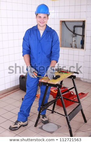 Young workman measuring copper pipe Stock photo © photography33