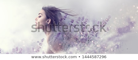 Art portrait of a beautiful  young woman with fresh flowers stock photo © gromovataya