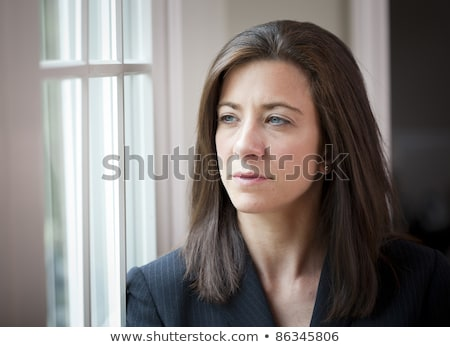 Portrait of brunette woman looking concerned Stock photo © photography33