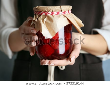 Woman with jar of jam Stock photo © photography33