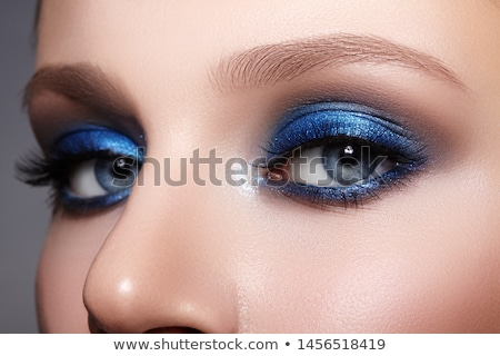 close up portrait of woman with beautiful blue eyes make up and stock photo © victoria_andreas
