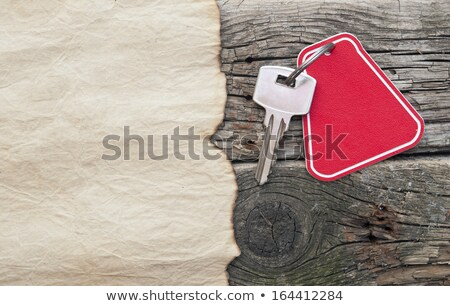 note paper and home keys with blank tag on wood background  Stock photo © inxti