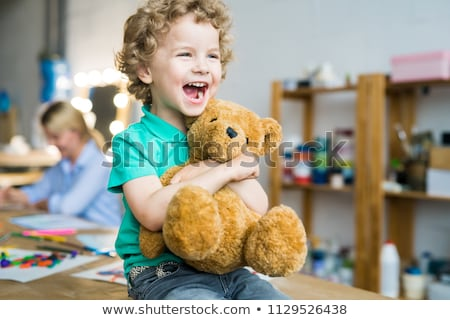 Blonde with a teddy bear  Stock photo © oneinamillion