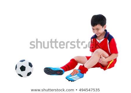 boy with injured leg and soccer ball stock photo © ilona75
