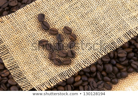 coffee beans on rustic dispersing the tissue stock photo © justinb