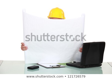 architect sat at desk reading plans stock photo © photography33