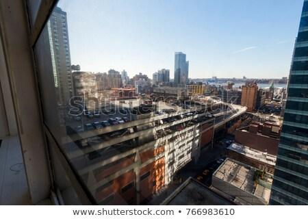 zon · groene · punt · buurt · skyline · rivier - stockfoto © eldadcarin