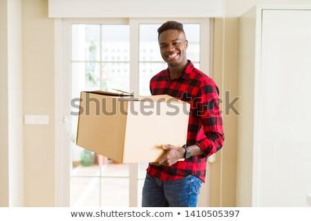 Stockfoto: Glimlachend · man · karton · vak · foto
