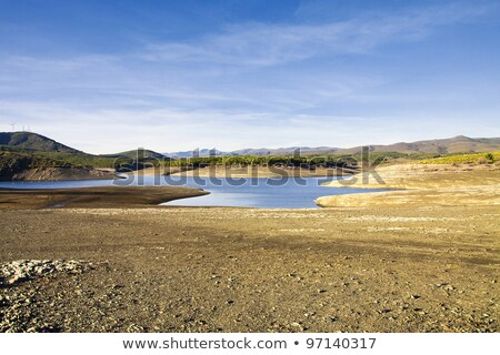 Earth dam wall with an empty dam Stock photo © Discovod