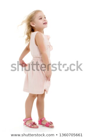Smiling girl with blowing hair stock photo © photosebia