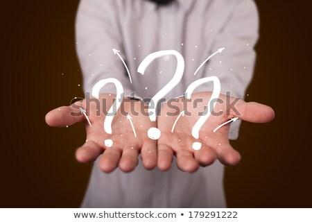 jonge · zakenman · presenteren · vraagtekens · zakenman - stockfoto © ra2studio