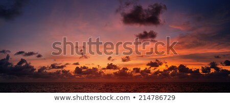 Psicodélico belo pôr do sol tropical oceano céu Foto stock © pzaxe