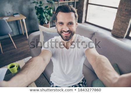 Przystojny facet młodych biały czarny tshirt Zdjęcia stock © georgemuresan