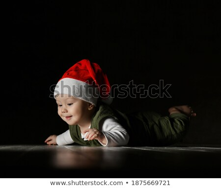 curious toddler in green clothing Stock photo © gewoldi
