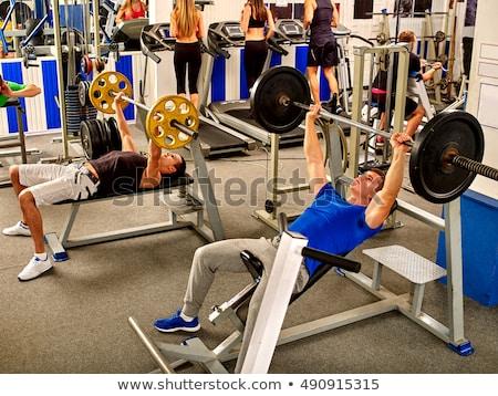 Dumbbell weightlifting man women group at mirror Stock photo © lunamarina