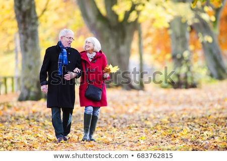 Young Woman Outdoors Walking In Autumn Woodland Holding Walking  Stock photo © monkey_business