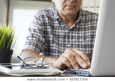 Old hands typing Stock photo © badmanproduction