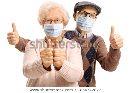 Senior woman showing thumbs up sign Stock photo © bmonteny