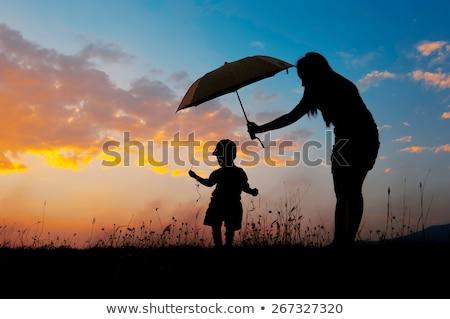 Chłopca parasol wygaśnięcia ilustracja chmury człowiek Zdjęcia stock © adrenalina