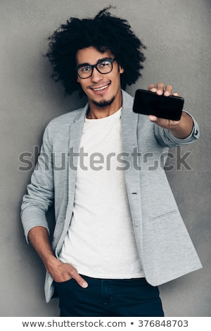 business man looking at you holding his hands in pocket stock photo © feedough