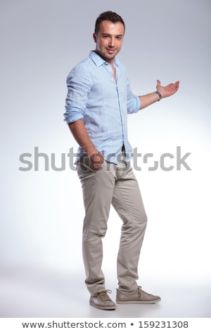 attractive fashion man holding his hands in pockxet stock photo © feedough