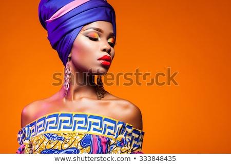Belo africano mulher em pé mãos quadris Foto stock © phakimata