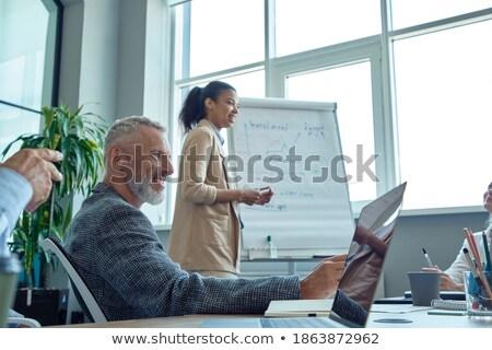 üzletasszony · magyaráz · grafikon · kollégák · üzlet · kéz - stock fotó © deandrobot
