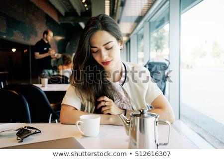 Moda mulher sessão olhando para baixo quadro Foto stock © feedough
