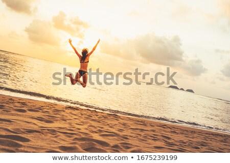 donna · spiaggia · indossare · bikini · Ocean · sabbia - foto d'archivio © wavebreak_media